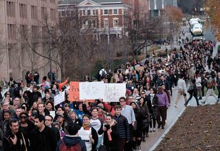 Syracuse University joined more than 80 colleges and universities in walking out of classes and protesting president-elect Donald's rhetoric during his campaign, specifically on immigration.